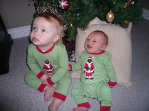 Benj, at 14 days old,  with his cousin Thomas under the Christmas tree at Grandma and Grandpa's