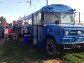 Guests grabbing some refreshments sold out of a big blue bus.