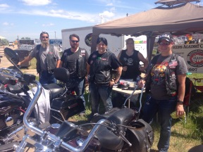 Bikers Against Child Abuse. Ben got a sweet temporary tatoo and a seat on a real hog.